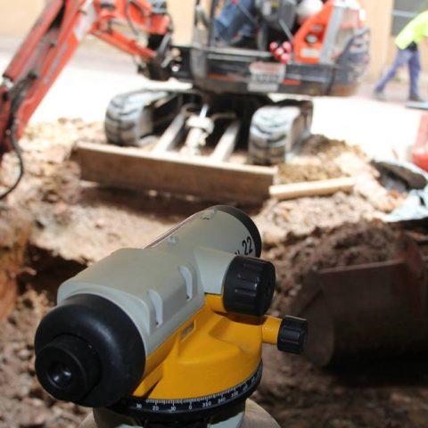 Level with excavator
